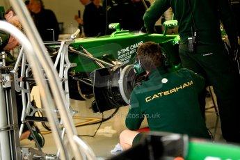 World © Octane Photographic Ltd. F1 British GP - Silverstone, Friday 28th June 2013 - Practice 1. Caterham F1 Team CT03 Garage. Digital Ref : 0724ce1d6843
