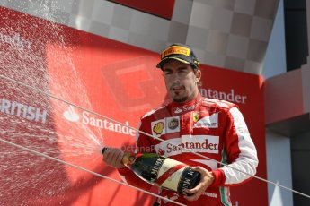 World © Octane Photographic Ltd. F1 British GP - Silverstone, Sunday 30th June 2013 - Race. Scuderia Ferrari F138 - Fernando Alonsosprays his champagne from the podium. Digital Ref : 0734lw1d2883