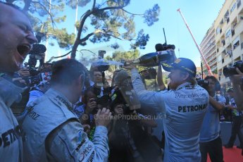 World © Octane Photographic Ltd. F1 Monaco GP, Monte Carlo - Sunday 26th May - Podium and celebrations. Mercedes AMG Petronas' Nico Rosberg sprays the team and the media with champagne after his lights to flag victory. Digital Ref : 0712lw1d2076