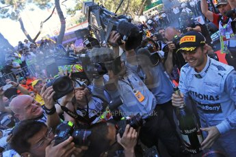 World © Octane Photographic Ltd. F1 Monaco GP, Monte Carlo - Sunday 26th May - Podium and celebrations. Mercedes AMG Petronas' Nico Rosberg sprays the team and the media with champagne after his lights to flag victory. Digital Ref : 0712lw1d2098