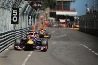 World © Octane Photographic Ltd. F1 Monaco GP, Monte Carlo - Sunday 26th May - Race. The Infiniti Red Bull Racing RB9 of Mark Webber and the Lotus F1 Team E21 of Kimi Raikkonen race out of Nouvelle Chicane. Digital Ref :