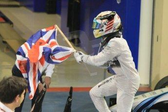 World © Octane Photographic Ltd. Sunday 23rd November 2014. Abu Dhabi Grand Prix - Yas Marina Circuit - Formula 1 Podium. Mercedes AMG Petronas – Lewis Hamilton - Race winner and 2014 World Champion. Digital Ref: 1173CB1D0408