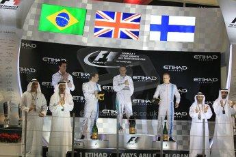World © Octane Photographic Ltd. Sunday 23rd November 2014. Abu Dhabi Grand Prix - Yas Marina Circuit - Formula 1 Podium. Mercedes AMG Petronas – Lewis Hamilton - Race winner and 2014 World Champion and Williams Racing - Felipe Massa (2nd) and Valtteri Bottas (3rd). Digital Ref: 1173CB1D0840