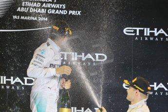 World © Octane Photographic Ltd. Sunday 23rd November 2014. Abu Dhabi Grand Prix - Yas Marina Circuit - Formula 1 Podium. Mercedes AMG Petronas – Lewis Hamilton - Race winner and 2014 World Champion. Digital Ref: 1173CB1D1140