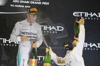 World © Octane Photographic Ltd. Sunday 23rd November 2014. Abu Dhabi Grand Prix - Yas Marina Circuit - Formula 1 Podium. Mercedes AMG Petronas – Lewis Hamilton - Race winner and 2014 World Champion. Digital Ref: 1173CB1D1156