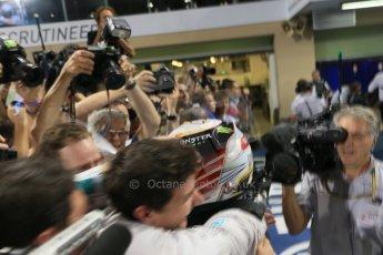 World © Octane Photographic Ltd. Sunday 23rd November 2014. Abu Dhabi Grand Prix - Yas Marina Circuit - Formula 1 Podium. Mercedes AMG Petronas – Lewis Hamilton - Race winner and 2014 World Champion greeting his team and family. Digital Ref: 1173LB1D7700