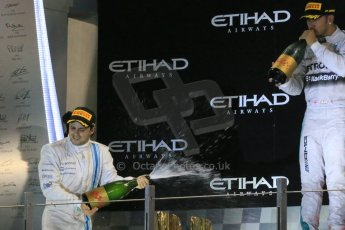 World © Octane Photographic Ltd. Sunday 23rd November 2014. Abu Dhabi Grand Prix - Yas Marina Circuit - Formula 1 Podium. Mercedes AMG Petronas – Lewis Hamilton - Race winner and 2014 World Champion. Digital Ref: 1173LB1DX7599