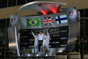 World © Octane Photographic Ltd. Sunday 23rd November 2014. Abu Dhabi Grand Prix - Yas Marina Circuit - Formula 1 Podium. Mercedes AMG Petronas – Toto Wolff and Lewis Hamilton - Race winner and 2014 World Champion and Williams Racing - Felipe Massa (2nd) and Valtteri Bottas (3rd). Digital Ref: 1173LB1DX7726