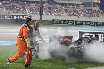 World © Octane Photographic Ltd. Sunday 23rd November 2014. Abu Dhabi Grand Prix - Yas Marina Circuit - Formula 1 Race. Lotus F1 Team E22 being extinguished by the fire marshals – Pastor Maldonado. Digital Ref: