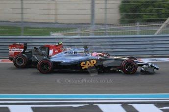 World © Octane Photographic Ltd. Sunday 23rd November 2014. Abu Dhabi Grand Prix - Yas Marina Circuit - Formula 1 Race. McLaren Mercedes MP4/29 - Jenson Button and Scuderia Ferrari F14T – Kimi Raikkonen. Digital Ref: