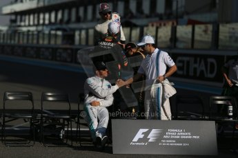 World © Octane Photographic Ltd. Sunday 23rd November 2014. Abu Dhabi Grand Prix - Yas Marina Circuit - End of season Formula 1 Drivers line up, Lewis Hamilton and Felipe Massa. Digital Ref: