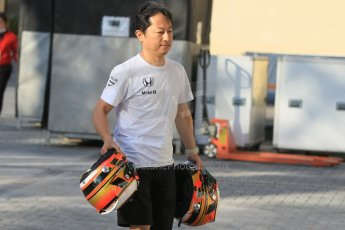 World © Octane Photographic Ltd. Tuesday 25th November 2014. Abu Dhabi Testing - Yas Marina Circuit. McLaren Honda - Stoffel Vandoorne's helmets are carried into the garage. Digital Ref: 1174CB1D1431