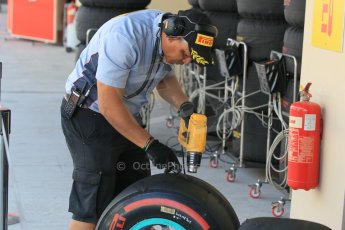 World © Octane Photographic Ltd. Wednesday 26th November 2014. Abu Dhabi Testing - Yas Marina Circuit. Pirelli technician with Mercedes wheel Digital Ref : 1175CB1D9152