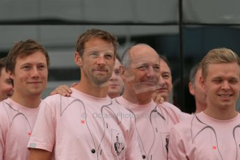 World © Octane Photographic Ltd. Saturday 5th July 2014. British GP, Silverstone, UK. - Formula 1 Paddock. Jenson Button, Kevin Magnussen, Ron Dennis and the McLaren team in their #Pinkforpapa shirts. Digital Ref: 1025LB1D0617