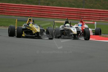 World © Octane Photographic Ltd. BRDC Formula 4 Championship. MSV F4-013. Silverstone, Sunday 27th April 2014. Sean Walkinshaw Racing (SWR) – Nicolas Beer battling with HHC Motorsport - Sennan Fielding. Digital Ref : 0916lb1d9575