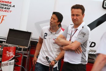 World © Octane Photographic Ltd. Thursday 17th July 2014. GP2 Paddock – German GP - Hockenheim. Takuya Izawa - ART Grand Prix and Emmanuel Esnault, McLaren Support operations Manager. Digital Ref : 1034CB7D4563