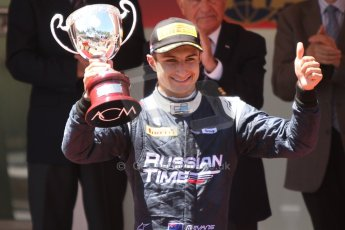 World © Octane Photographic Ltd. Friday 23rd May 2014. GP2 Feature Race – Monaco, Monte Carlo. Mitch Evans raises his 2nd place trophy - RT Russian Time. Digital Ref : 0963CB7D3127