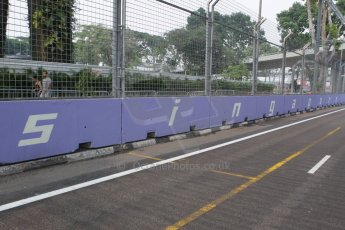 World © Octane Photographic Ltd. Wednesday 17th September 2014, Singapore Grand Prix, Marina Bay. Formula 1 Setup and atmosphere. Singapore trackside sign-writing. Digital Ref: 1115CB1D6512