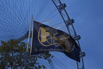 World © Octane Photographic Ltd. Wednesday 17th September 2014, Singapore Grand Prix, Marina Bay. Formula 1 Setup and atmosphere. FIA flag at night. Digital Ref: 1115CB6699