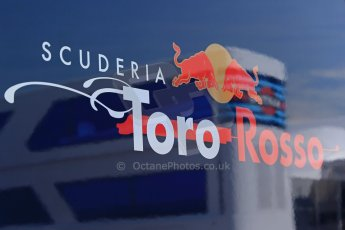 World © Octane Photographic Ltd. Thursday 8th May 2014. Circuit de Catalunya - Spain - Formula 1 Paddock. Scuderia Toro Rosso logo with reflection of Williams Martini Racing logo. Digital Ref: 0922lb1d2852
