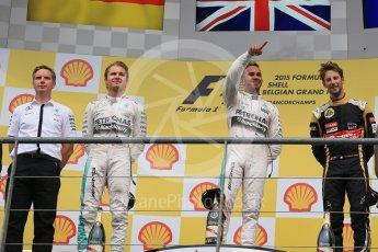 World © Octane Photographic Ltd. Mercedes AMG Petronas F1 W06 Hybrid – Lewis Hamilton (1st), Nico Rosberg (2nd) and Lotus F1 Team E23 Hybrid – Romain Grosjean (3rd). Sunday 23rd August 2015, F1 Belgian GP Podium, Spa-Francorchamps, Belgium. Digital Ref: 1390LB1D2285