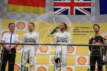 World © Octane Photographic Ltd. Mercedes AMG Petronas F1 W06 Hybrid – Lewis Hamilton (1st), Nico Rosberg (2nd) and Lotus F1 Team E23 Hybrid – Romain Grosjean (3rd). Sunday 23rd August 2015, F1 Belgian GP Podium, Spa-Francorchamps, Belgium. Digital Ref: 1390LB1D2307