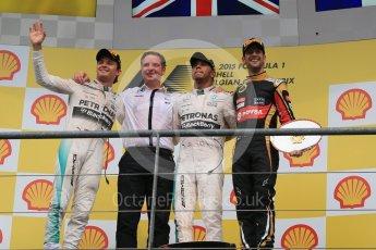 World © Octane Photographic Ltd. Mercedes AMG Petronas F1 W06 Hybrid – Lewis Hamilton (1st), Nico Rosberg (2nd) and Lotus F1 Team E23 Hybrid – Romain Grosjean (3rd). Sunday 23rd August 2015, F1 Belgian GP Podium, Spa-Francorchamps, Belgium. Digital Ref: 1390LB1D2493