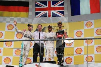 World © Octane Photographic Ltd. Mercedes AMG Petronas F1 W06 Hybrid – Lewis Hamilton (1st), Nico Rosberg (2nd) and Lotus F1 Team E23 Hybrid – Romain Grosjean (3rd). Sunday 23rd August 2015, F1 Belgian GP Podium, Spa-Francorchamps, Belgium. Digital Ref: 1390LB1D2501