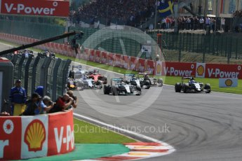 World © Octane Photographic Ltd. Mercedes AMG Petronas F1 W06 Hybrid – Lewis Hamilton and Sahara Force India VJM08B – Sergio Perez side by side into La Source hairpin on lap 1. Sunday 23rd August 2015, F1 Belgian GP Race, Spa-Francorchamps, Belgium. Digital Ref: 1389LB1D2021