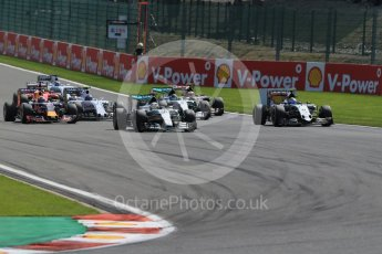 World © Octane Photographic Ltd. Mercedes AMG Petronas F1 W06 Hybrid – Lewis Hamilton and Sahara Force India VJM08B – Sergio Perez side by side into La Source hairpin on lap 1. Sunday 23rd August 2015, F1 Belgian GP Race, Spa-Francorchamps, Belgium. Digital Ref: 1389LB1D2025