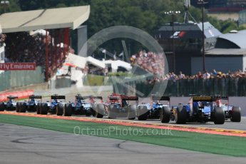 World © Octane Photographic Ltd. The pack heads down toward Eau Rouge for the first time. Sunday 23rd August 2015, F1 Belgian GP Race, Spa-Francorchamps, Belgium. Digital Ref: 1389LB1D2067