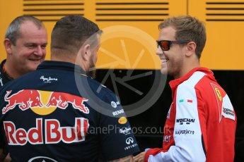 World © Octane Photographic Ltd. Scuderia Ferrari SF15-T– Sebastian Vettel and Red Bull crew. Friday 4th September 2015, F1 Italian GP Practice 1, Monza, Italy. Digital Ref: 1405LB1D8686