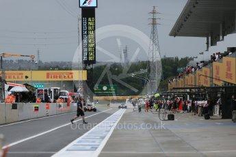 World © Octane Photographic Ltd. Pitlane at start of session. Friday 25th September 2015, F1 Japanese Grand Prix, Practice 2, Suzuka. Digital Ref: