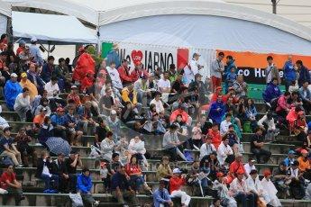 World © Octane Photographic Ltd. Fans in a wet open grandstand. Friday 25th September 2015, F1 Japanese Grand Prix, Practice 2, Suzuka. Digital Ref: