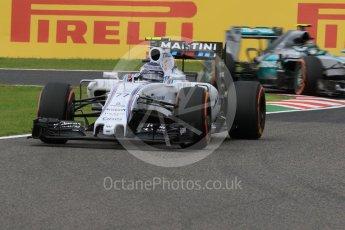 World © Octane Photographic Ltd. Williams Martini Racing FW37 – Valtteri Bottas and Mercedes AMG Petronas F1 W06 Hybrid – Nico Rosberg. Saturday 26th September 2015, F1 Japanese Grand Prix, Practice 3, Suzuka. Digital Ref: