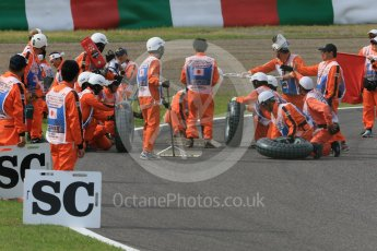 "World © Octane Photographic Ltd. Marshals' ""tyre change"". Saturday 26th September 2015, F1 Japanese Grand Prix, Qualifying, Suzuka. Digital Ref:"