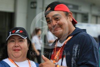 "World © Octane Photographic Ltd. Fan with ""I Love F1"" hat. Sunday 27th September 2015, F1 Japanese Grand Prix, Paddock, Suzuka. Digital Ref: 1448CB7D7538"