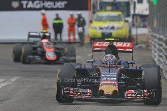 World © Octane Photographic Ltd. Scuderia Toro Rosso STR10 – Carlos Sainz Jnr and McLaren Honda MP4/30 - Jenson Button. Thursday 21st May 2015, F1 Practice 2, Monte Carlo, Monaco. Digital Ref: 1274CB7D3658