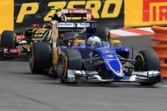 World © Octane Photographic Ltd. Sauber F1 Team C34-Ferrari – Marcus Ericsson and Lotus F1 Team E23 Hybrid – Pastor Maldonado. Thursday 21st May 2015, F1 Practice 1, Monte Carlo, Monaco. Digital Ref: 1272CB7D2990