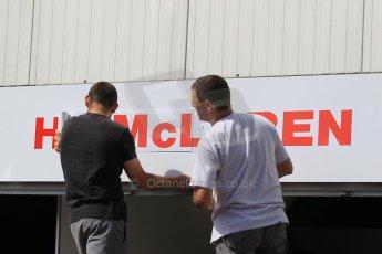 "World © Octane Photographic Ltd. McLaren Honda garage being relabelled fro original ""Honda McLaren"" to ""McLaren Honda"". Wednesday 20th May 2015, F1 Pitlane, Monte Carlo, Monaco. Digital Ref: 1270CB1L9102"