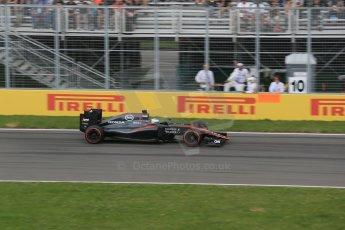 World © Octane Photographic Ltd. McLaren Honda MP4/30 – Fernando Alonso. Friday 5th June 2015, F1 Canadian GP Practice 2, Circuit Gilles Villeneuve, Montreal, Canada. Digital Ref: 1292LB1D0266