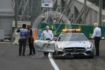 World © Octane Photographic Ltd. Charlie Whiting and Herbie Blash examining the new 12 after the new Anderson bridge layout change. Friday 18th September 2015, F1 Singapore Grand Prix Practice 1, Marina Bay. Digital Ref: 1428LB1L9638