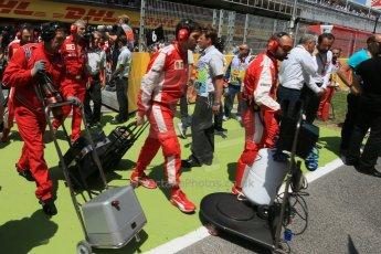 World © Octane Photographic Ltd. Scuderia Ferrari - Maurizio Arrivabene and the team leave the grid. Sunday 10th May 2015, F1 Spanish GP Formula 1 Grid, Circuit de Barcelona-Catalunya, Spain. Digital Ref: 1264LB1D0141