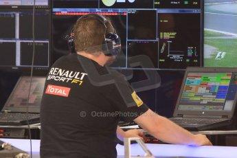 World © Octane Photographic Ltd. Infiniti Red Bull Racing RB11 and Renault engine technician. Thursday 7th May 2015, F1 Spanish GP Pitlane, Circuit de Barcelona-Catalunya, Spain. Digital Ref: 1244CB7D1660