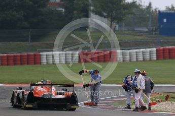 World © Octane Photographic Ltd. FIA World Endurance Championship (WEC), 6 Hours of Nurburgring , Germany - Practice 3, Saturday 29th August 2015. G-Drive Racing – Nissan Ligier JS P2 – LMP2 – Roman Rusinov, Julien Canal and Sam Bird pass marshals clearing gravel from the track. Digital Ref : 1395LB1D5363