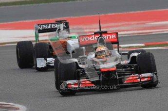 © Octane Photographic 2011. Formula 1 testing Sunday 20th February 2011 Circuit de Catalunya. McLaren MP4/26 - Lewis Hamilton, Force India VJM04 - Adrian Sutil. Digital ref : 0010LW7D3696