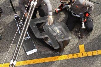 World © Octane Photographic 2011. Formula 1 testing Wednesday 9th March 2011 Circuit de Catalunya. McLaren MP4/26 - Lewis Hamilton tyre change practice. Digital ref : 0020LW7D0683