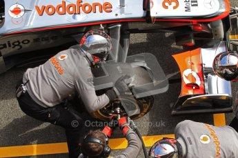 World © Octane Photographic 2011. Formula 1 testing Wednesday 9th March 2011 Circuit de Catalunya. McLaren MP4/26 - Lewis Hamilton tyre change practice. Digital ref : 0020LW7D0690