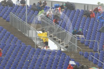 World © Octane Photographic Ltd. Fans in the grandstands during the thunderstorm. Friday 1st July 2016, F1 Austrian GP Practice 2, Red Bull Ring, Spielberg, Austria. Digital Ref : 1600CB1D2488
