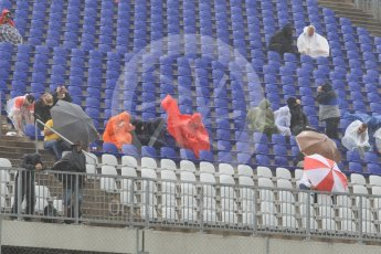World © Octane Photographic Ltd. Fans in the grandstands during the thunderstorm. Friday 1st July 2016, F1 Austrian GP Practice 2, Red Bull Ring, Spielberg, Austria. Digital Ref : 1600CB1D2493